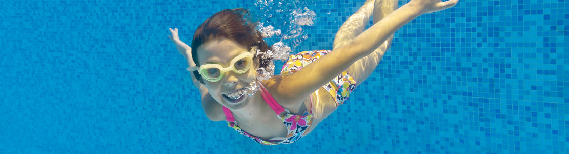 Underwater girl yellow goggles